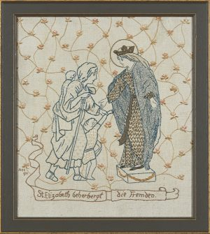A framed embroidered woolwork panel of St. Elizabeth befriending a pilgrim. Bears embroidered inscription ST. ELIZABETH BEHERBERGT DIE FREMDEN,