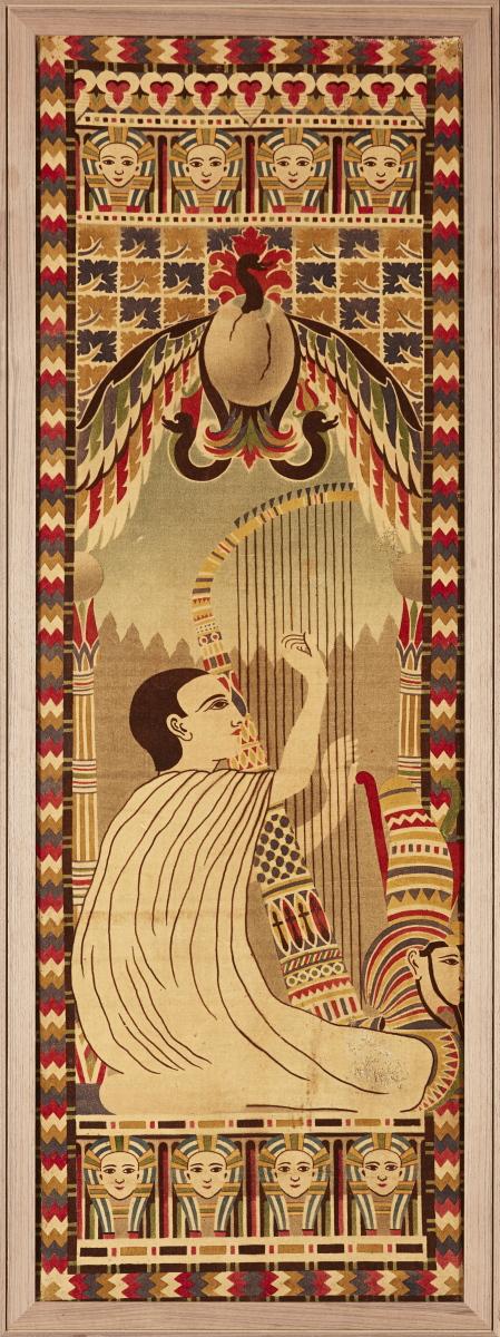 A framed French Egyptian Revival printed velvet panel.