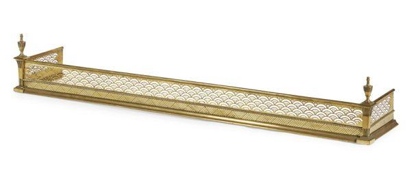 An Aesthetic Movement brass fender.