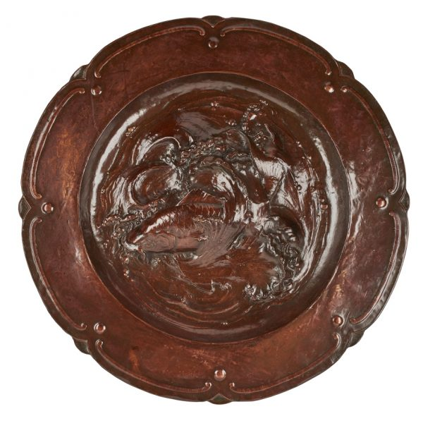 A large Japanese repousse copper wall charger.
