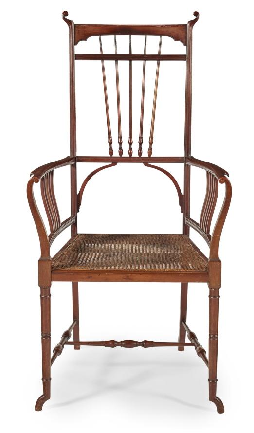 An Aesthetic Movement mahogany armchair.