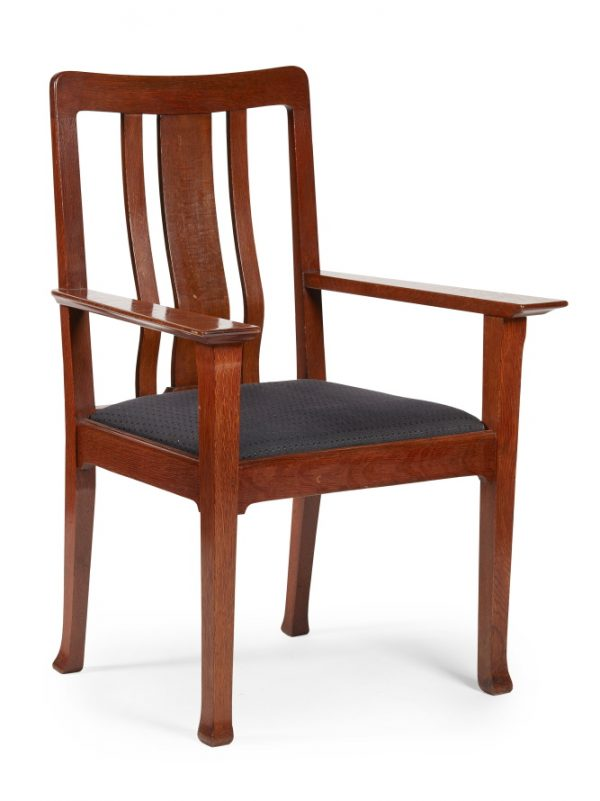 A rare Arts and Crafts oak armchair by Charles Robert Ashbee for The Guild of Handicraft