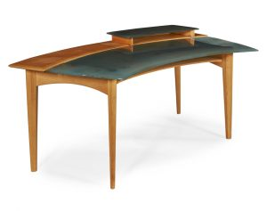 A Venini glass and beech wood desk with pivoting open shelf.