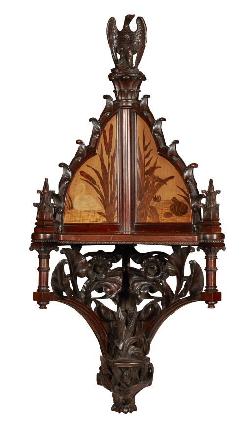 An Aesthetic Movement Carved Mahogany Corner Wall Bracket.