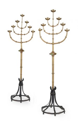 A pair of English School Gothic Revival  brass standing candelabra.