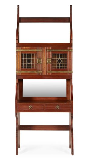 An Aesthetic Movement walnut side cabinet with two glazed and leaded panel doors.