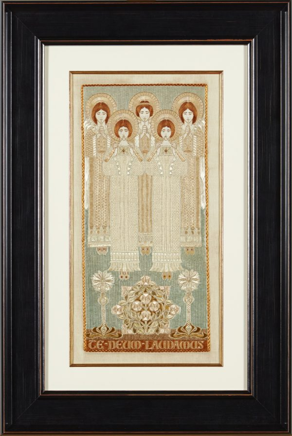 A framed Arts & Crafts embroidered silkwork panel. Worked in coloured silks with five ascending angels and an inscription TEDEUM LAUDAMUS. From Paul Reeves London