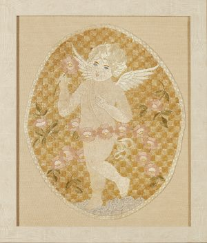A framed silkwork embroidered panel, worked as a winged putto.