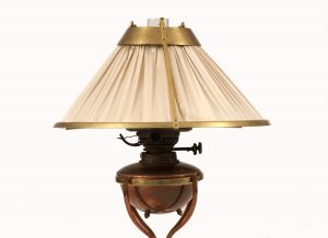 An Arts & Crafts brass and copper table lamp