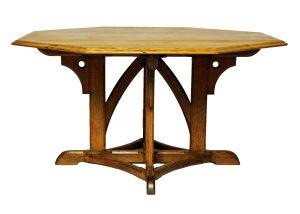 An octagonal oak library table