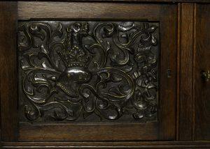 An oak Gothic Revival cabinet