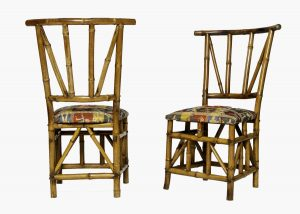 A pair of bamboo chairs