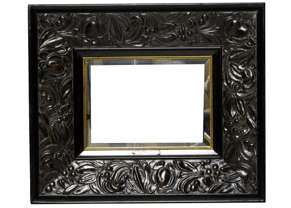 A carved Arts and Crafts mirror
