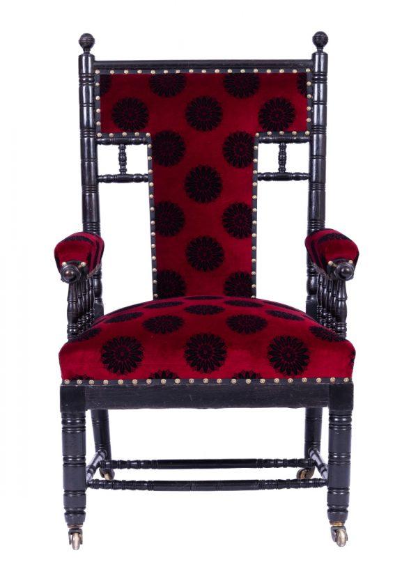 An ebonised armchair