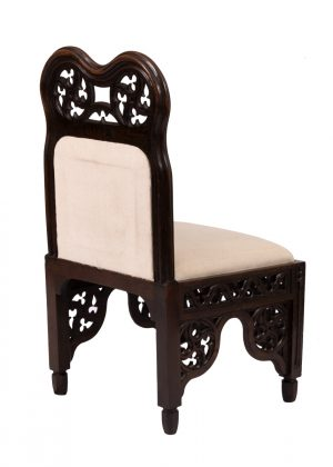 a wooden chair by Lewis Nockalls Cottingham for Brougham Hall, Cumberland