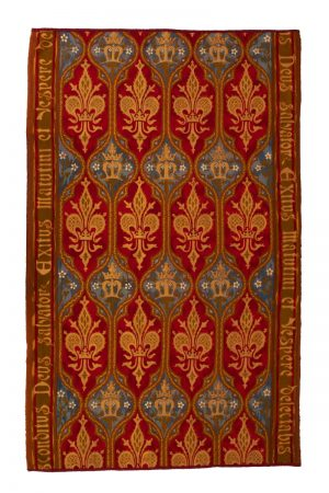 A needlework rug designed by A.W.N. or E.W. Pugin. Provenance: St Leonards, Mayfield, Sussex. The Chapel. Worked by The Sisters. Sectional part of a very long carpet runner.