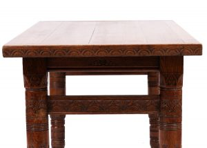 A carved oak library table