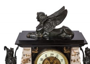 A French Egyptian Revival clock and obelisks