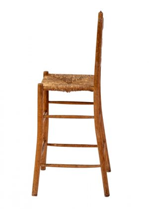 A child's Cotswolds School high chair