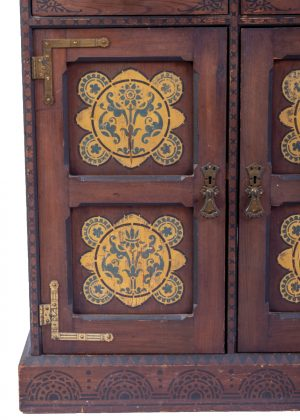 A decorated Art Movement cabinet